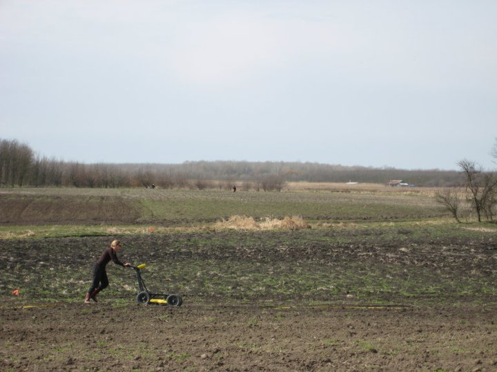 field in Hungary with person conducting geophysical survey